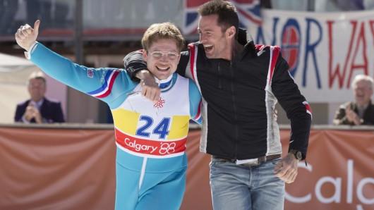 Sieger der Herzen: Eddie the Eagle (Taron Egerton) und Trainer Bronson (Hugh Jackman) rocken die Winterolympiade 1988